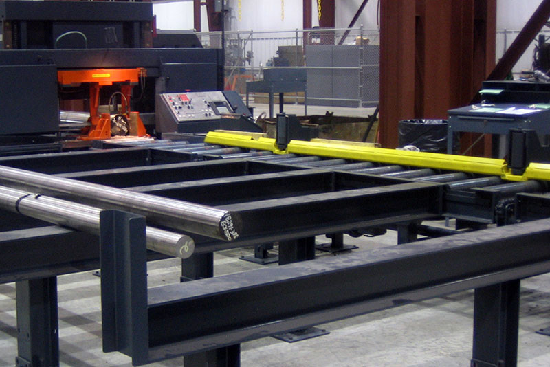 Outfeed Conveyor Pushbar Ejector System pushes Finished Material onto Skids