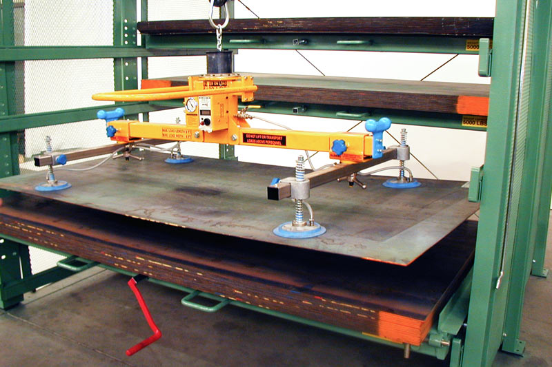 Sheet Steel Retrieved with Vacuum Lifter from Crank-Out Sheet Metal Rack